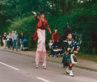 Piper leads stilt walker 04
